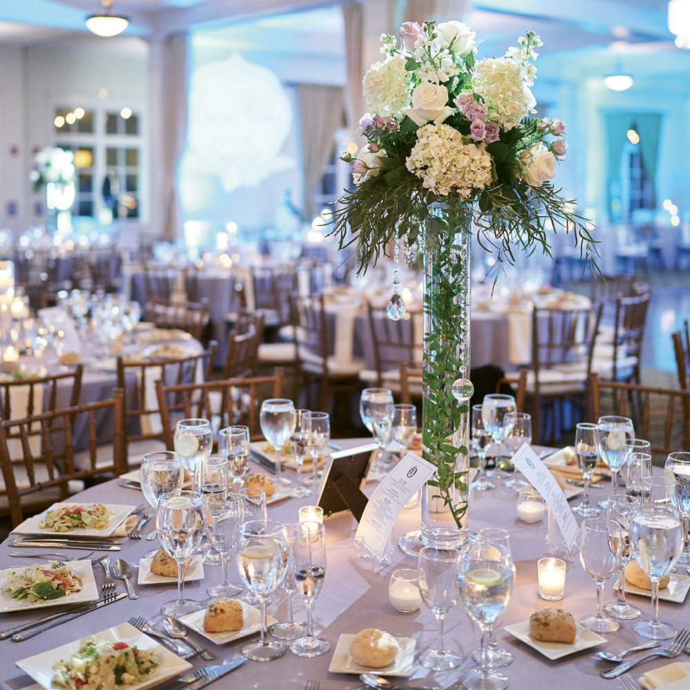 Centerpieces consisted of a mix of high arrangements, candles and silver trees with elegant jewels.