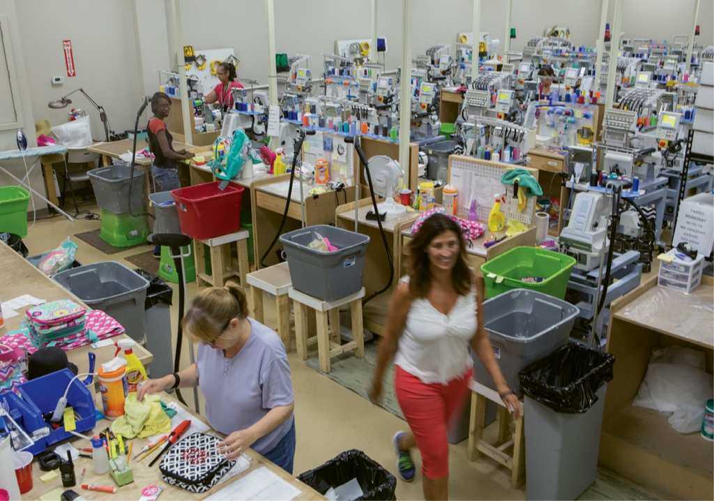 Wholesale Boutique's massive warehouse is where the brand's production thrives, from embroidering and engraving monograms to cutting and sewing.