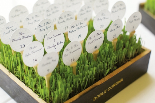Their May wedding at the Surf Golf & Beach Club featured their love of golf with seat assignments in the shape of golf balls and tees.