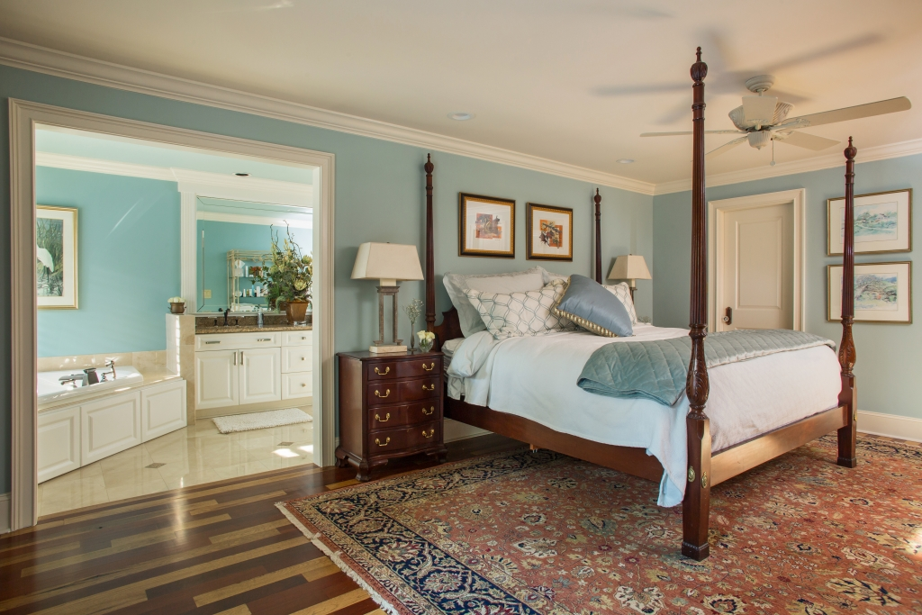 Master Class: A master bedroom was deftly retrofitted downstairs, looking as though it had always been there. The hickory and Brazilian cherry floor is design eye candy.