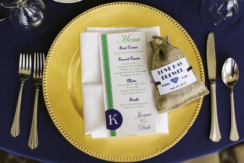 Their colors of white, navy and pops of green were highlighted in the wedding favors and centerpieces.