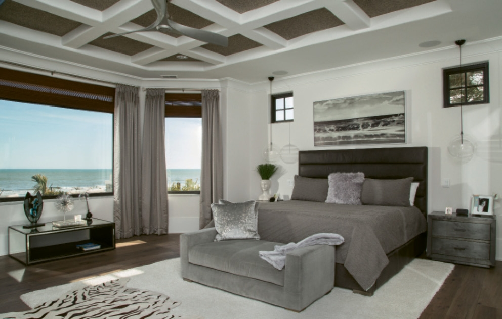 The master suite veers off from usual beachy decor to reflect one of those magical, moody and misty days at the ocean.