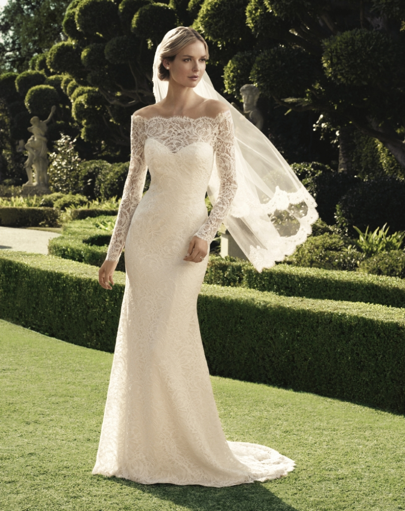 casablanca bridal Sheer off-the-shoulder neckline design with long sleeves and scalloped eyelash fringe accents the neckline and hemline of this sheath silhouette. Style 2169. Amanda's Collection, $1,235