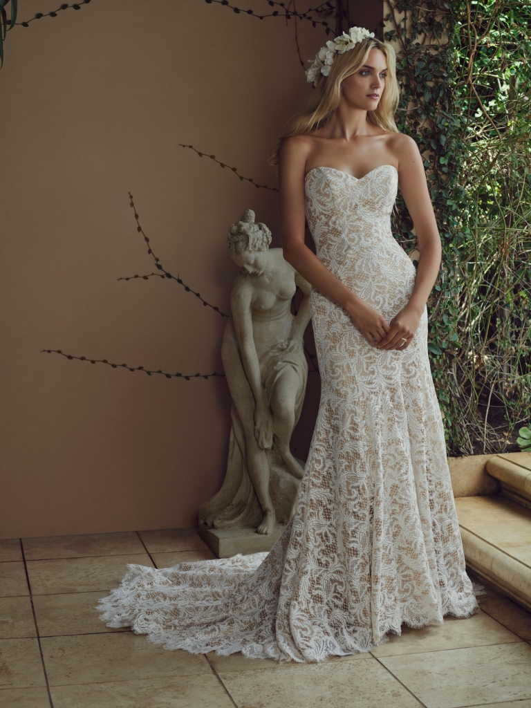 "woodland Florals ""Water Lily"" is the name of this Chantilly lace Casablanca gown featuring a strapless sweetheart neckline and lace texture. The dark champagne lining and chapel train complete this garden wedding look. Amanda's Collection, $1,280"