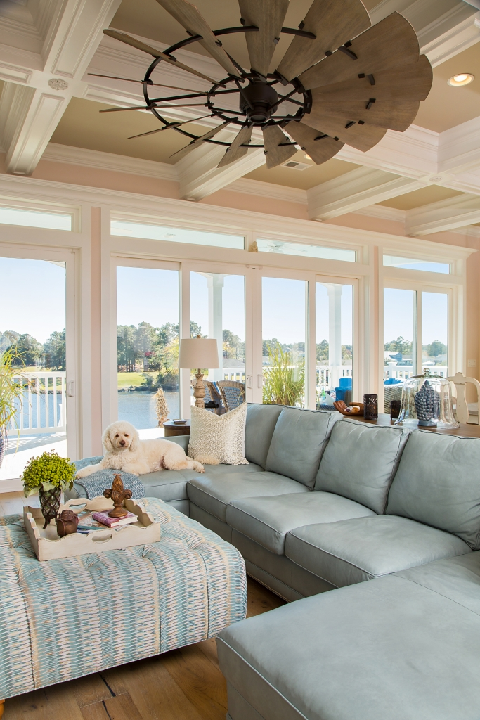 Ease And Grace: The Youmans' home is a decor statement in peace and tranquility. Lola, the family Labradoodle, loves to camp out in the airy main living area that overlooks the Intracoastal Waterway.