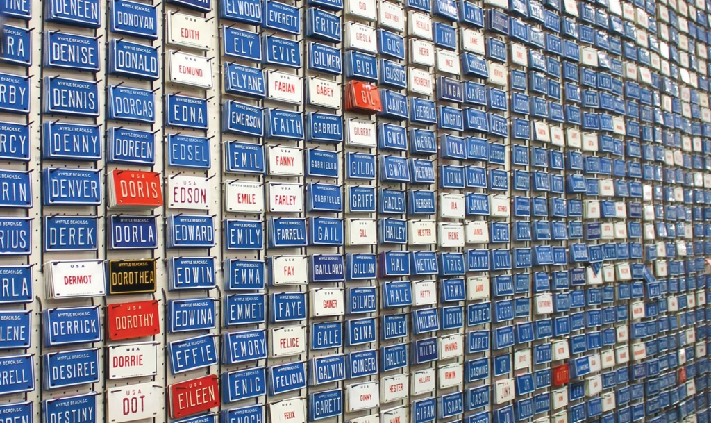 The store's most popular item? The blue bicycle license plate tags featuring every name you can imagine, lined from the ceiling to the floor along a wall near the Boulevard entrance.