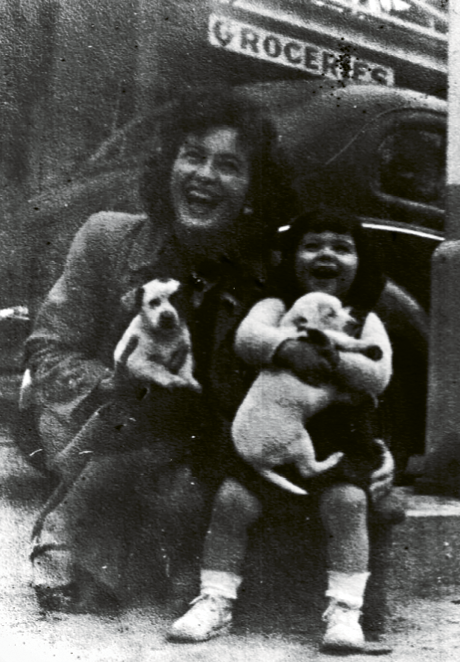 Buz's mother, Eloise, and his sister, Kay, pose with two puppies in Myrtle Beach in 1938.