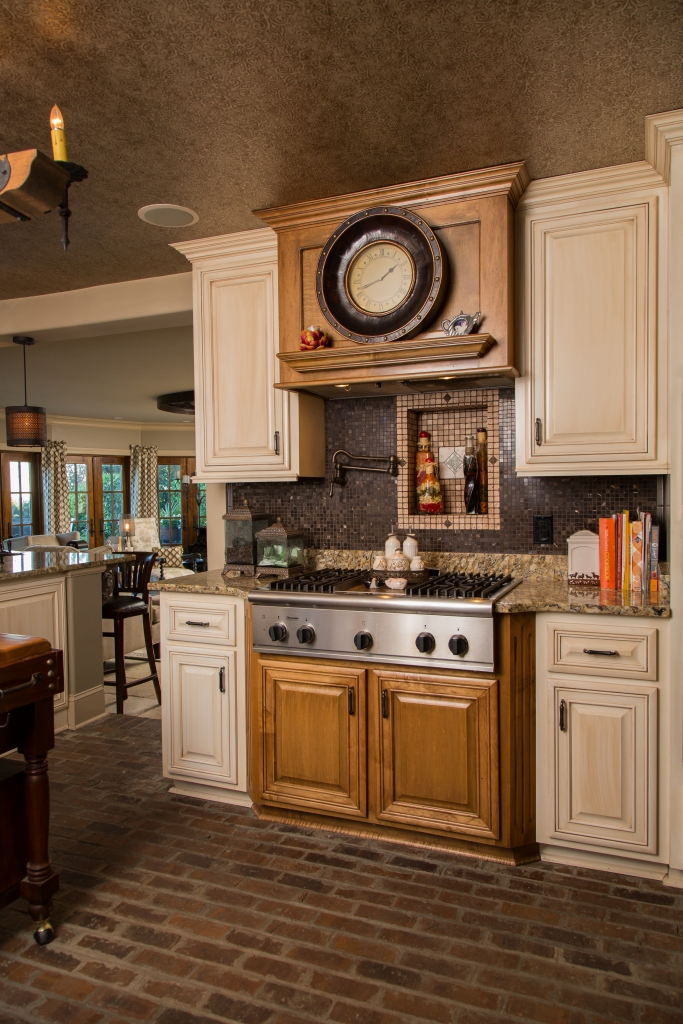 Kitchen Capers: Barbara used a mix of finishes and textures in the kitchen to achieve a classic yet provocative effect.  Brick, mosaic tile, stone and limestone make this modest kitchen live large.