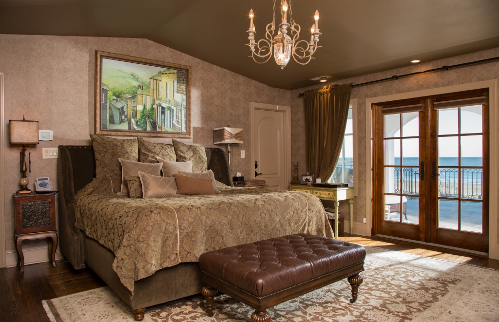 Bedtime Story: The master suite in the Graham home follows design suit with relaxed earthy tones and an ocean presence through French doors.