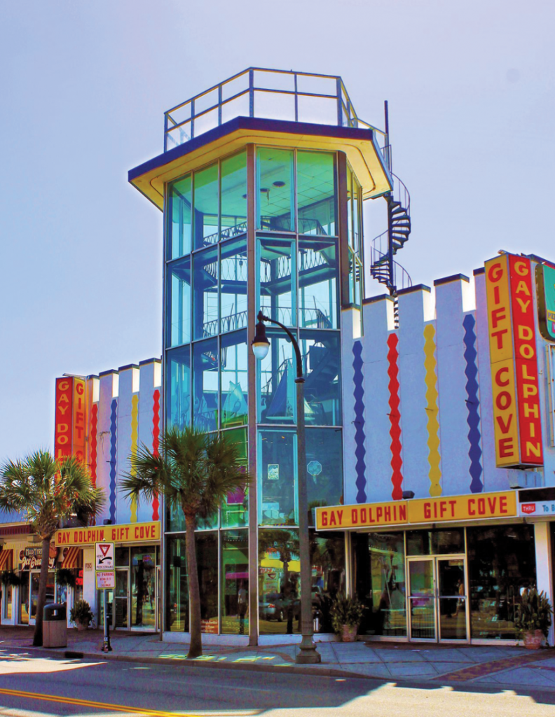 The Gay Dolphin Gift Cove features an iconic observation tower over Ocean Boulevard.