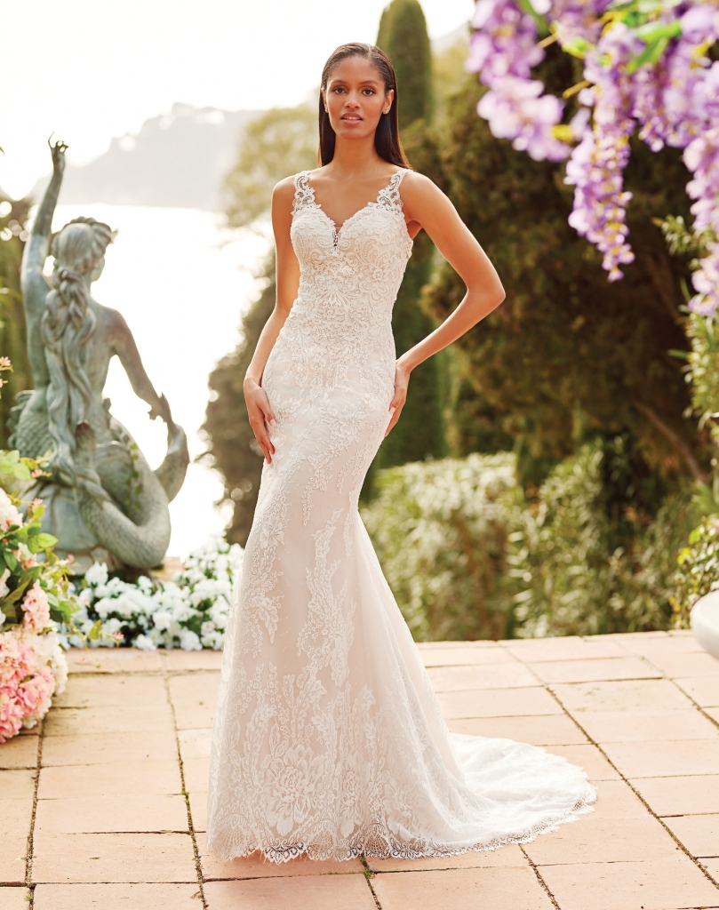 Justin Alexander - Featuring a V-neck with sequined lace and a keyhole back, this Sincerity fit and flare gown's chapel length train completes its beautiful look. Fancy Frocks; $1,400