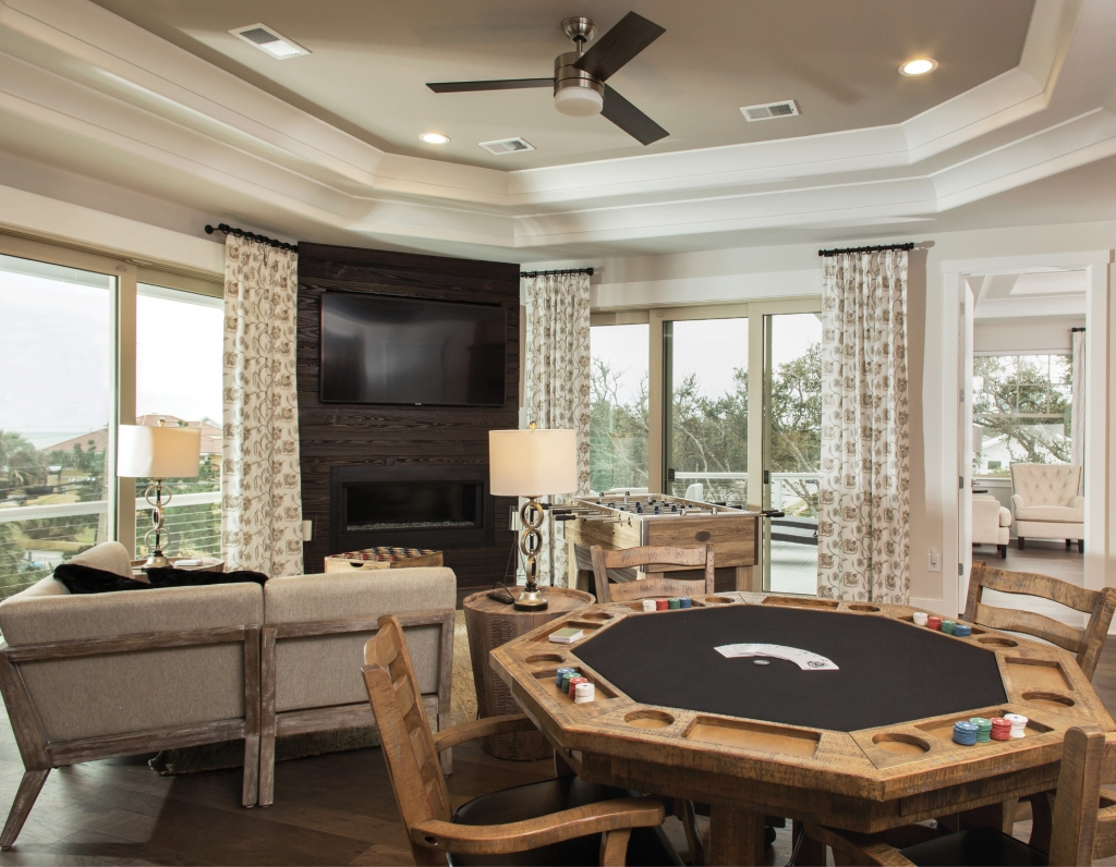5301 Ocean Village, Myrtle Beach - Gathering Place: This home is all about family fun throughout the minimal, modern open floor plan, which includes a gas fireplace, game pieces and cozy seating.