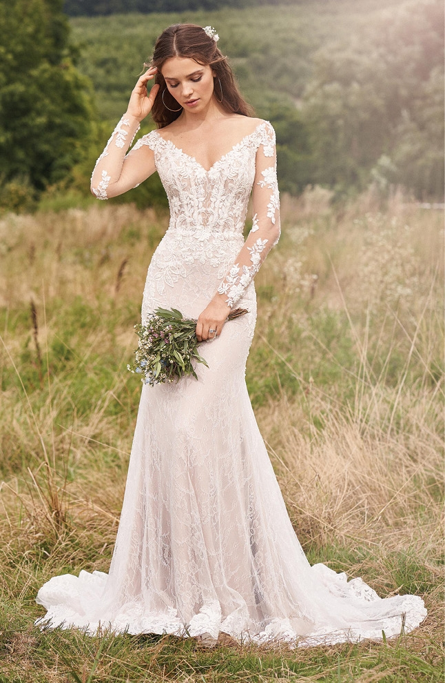 Lillian West - This long-sleeve gown features all-over Chantilly and beaded lace. The structured illusion bodice with exposed boning defines your natural curves.  The Little White Dress; price available upon request