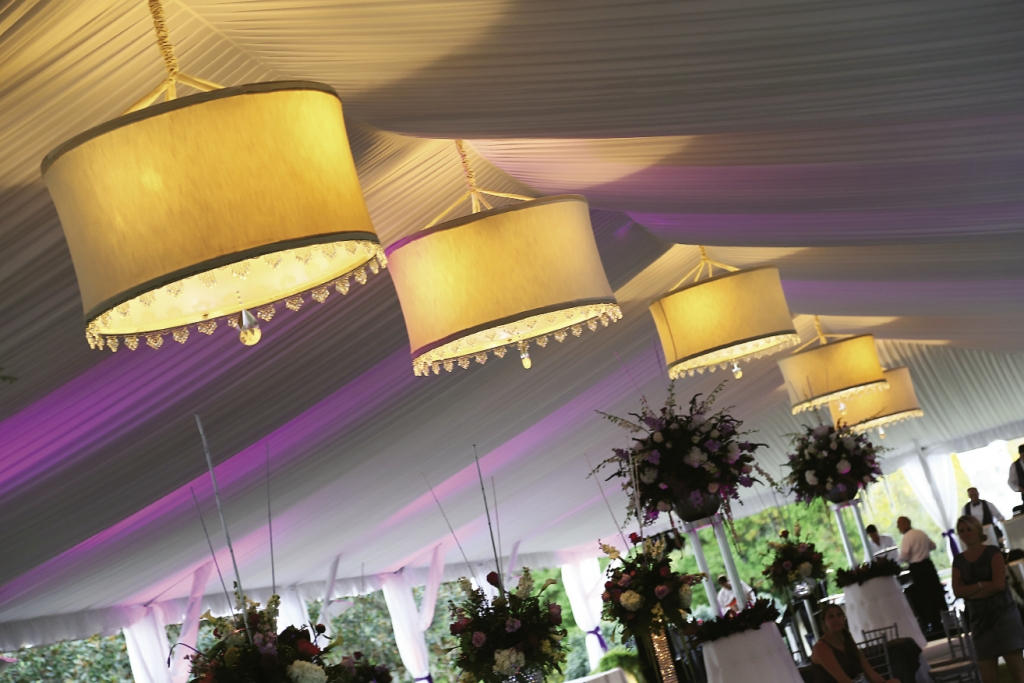 The reception tent had five custom-made chandeliers and was draped and uplit with changeable lighting.