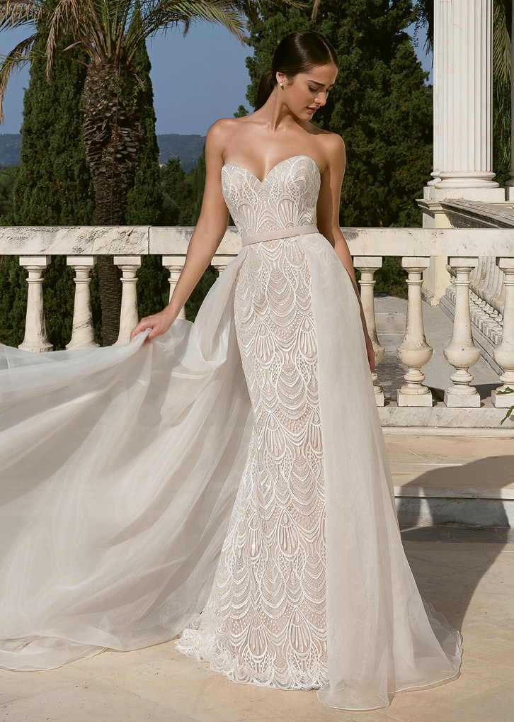 Justin Alexander This sweetheart neckline fit and flare gown brings the glamour. The all-over sequined lace dress is paired with a detachable organza skirt. The Little White Dress; $2,222