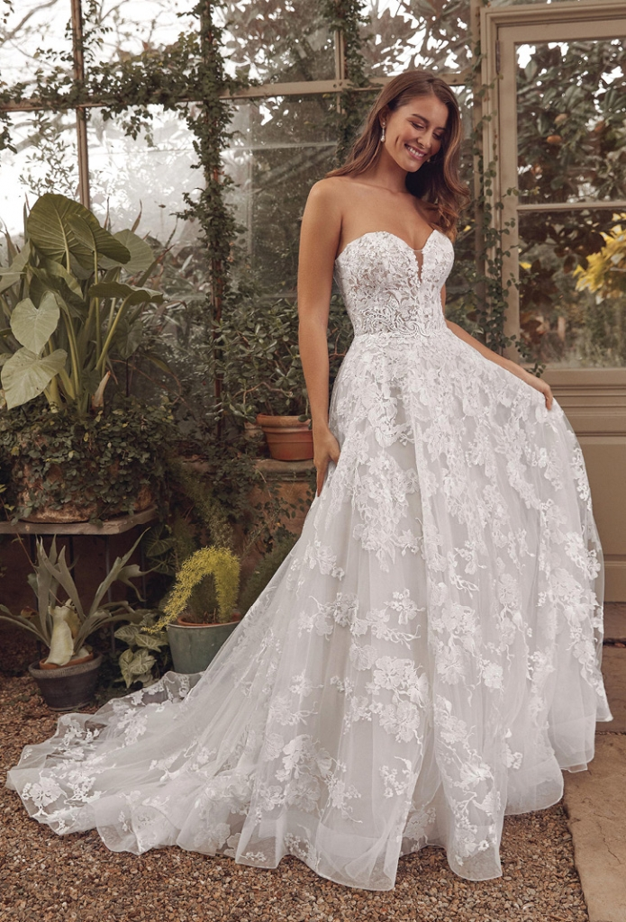 Justin Alexander - The Addison is a vintage-inspired sweetheart ball gown with a modern twist, featuring all-over embroidery and Chantilly lace. The illusion bodice features a small plunge. The Little White Dress; price available upon request