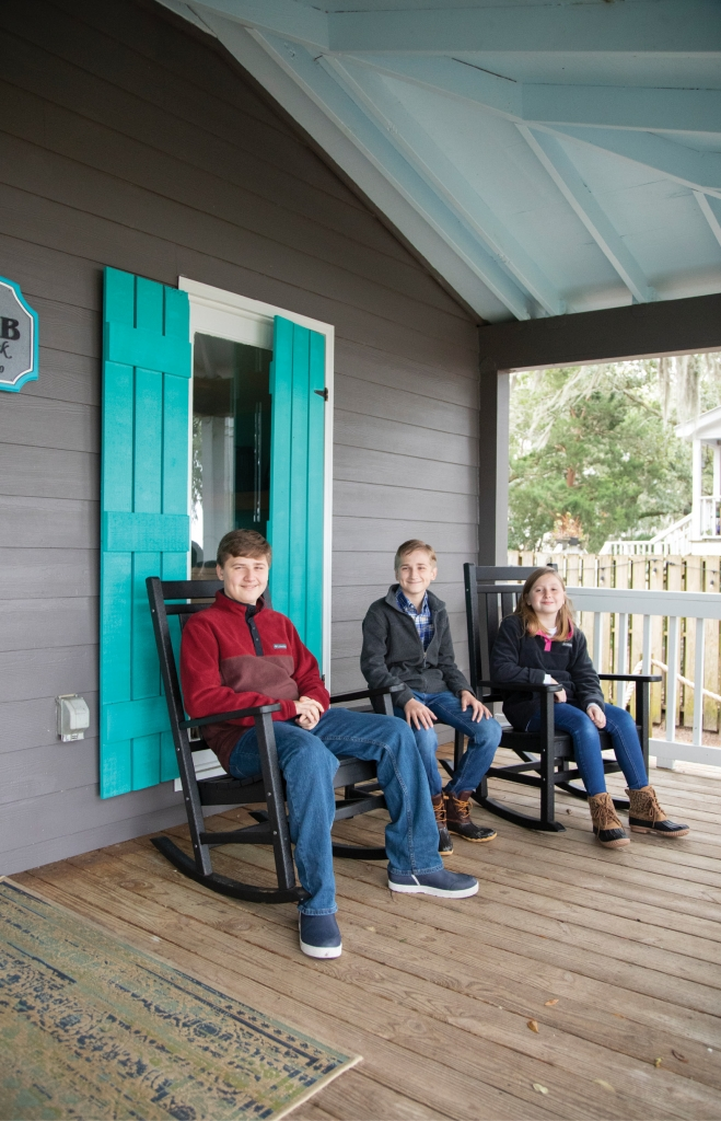 FUTURE VIEWS: The Perry siblings relax on the lodge's back porch that overlooks breathtaking views of the inlet.