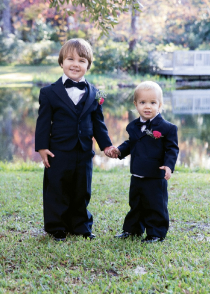 The intimate wedding party included the pair's sons, one as ring bearer and one throwing flower petals.