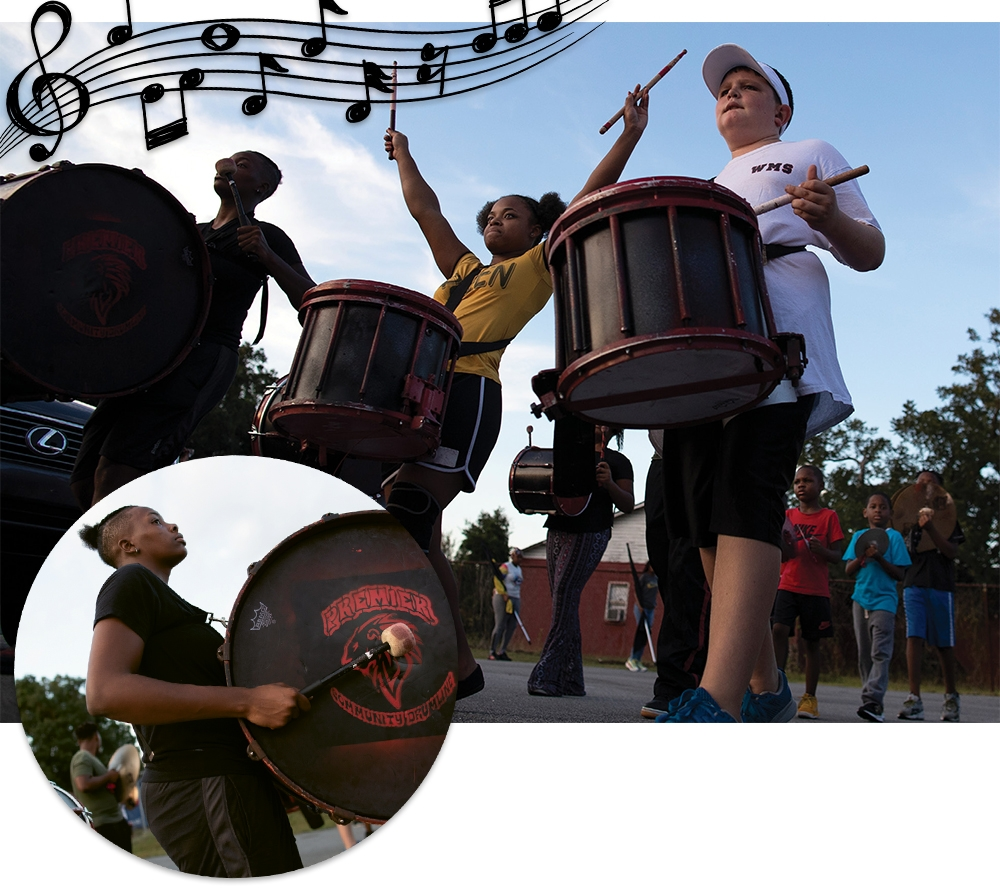 Top, from left: Justis Evans, Faith Gurley and Hunter Davis, a snare drummer and one of the newest members, practice a marching routine at dusk. Evans is also pictured inset.