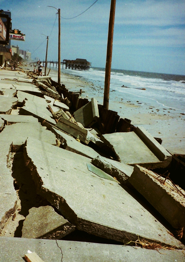 The cement boardwalk that ran along businesses on the beach in downtown Myrtle Beach was destroyed by Hurricane Hugo in 1989. The damage from the storm surge not only destroyed much along the oceanfront, but also put Ocean Boulevard beneath four feet of sand.