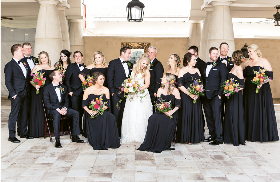 Breath of Fresh Air: Bree changed up the traditional bridal party color palette, going with knockout colors in the bouquets and classic black gowns.