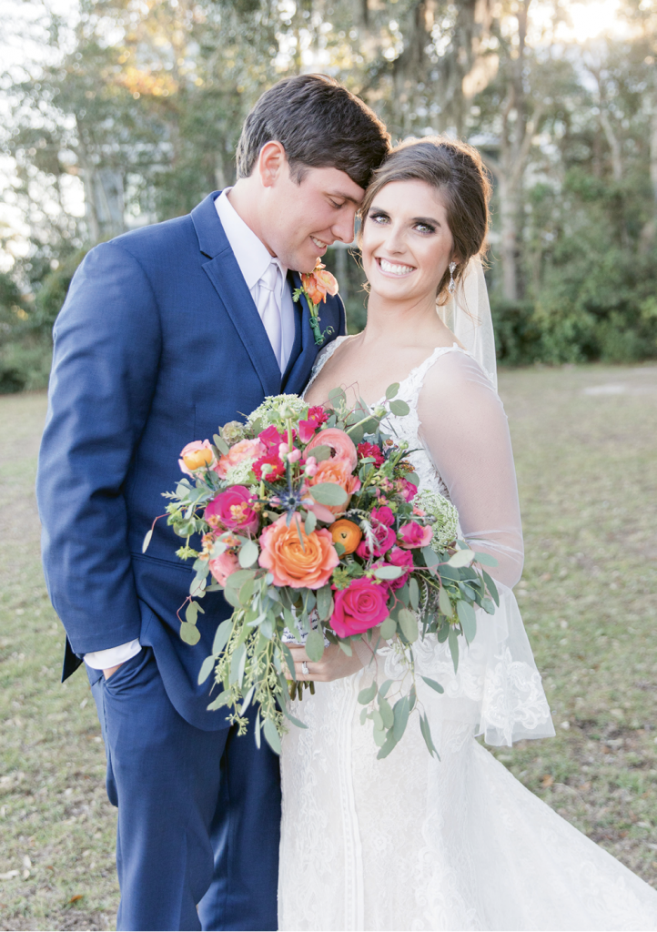 After seeing Sean in a navy suit at a friend's wedding, Emily knew it would be the perfect look for theirs, too. Hair and makeup was provided by Beautiful Salon & Spa, with equipment rentals from EventWorks and videography by Brandon and Sarah Talley.