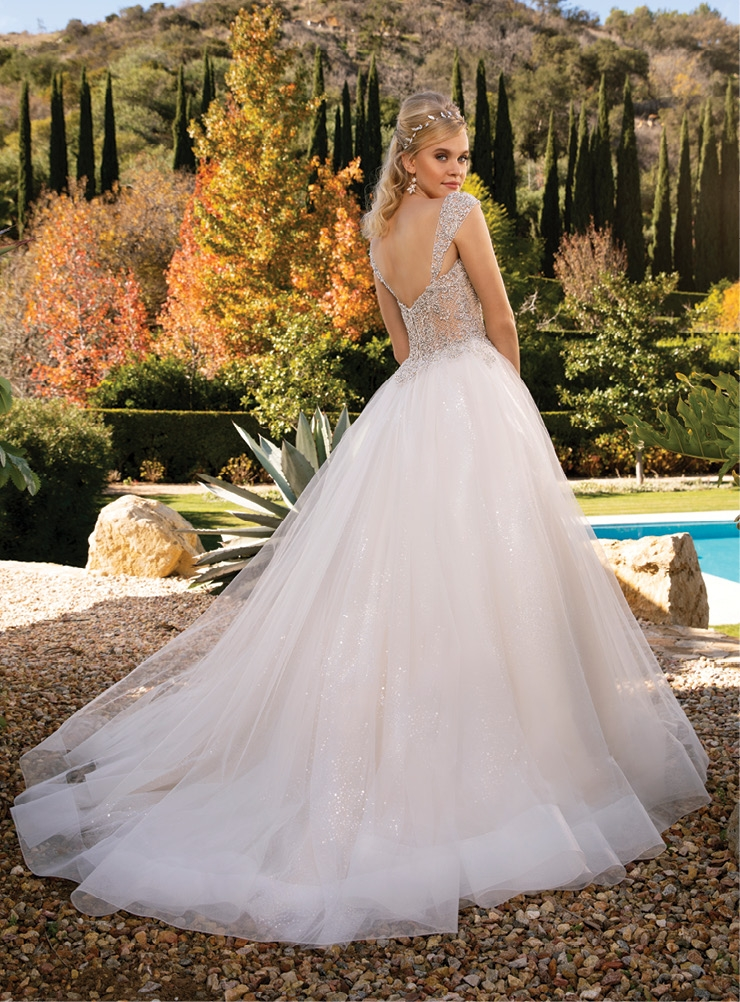 Casablanca - The Rosalie is a stunning ball gown featuring an intricately beaded illusion bodice accented by a sweetheart neckline. Amanda's Collection; $1,549