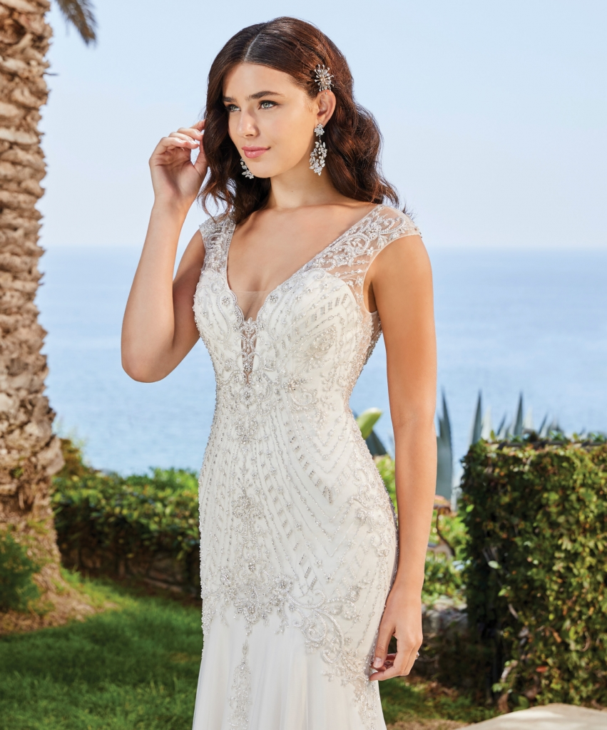 Casablanca - This Leilani fit and flare gown catches the light at every angle. The beading and embroidery covering the entire bodice are perfect for a bride who loves bling. Amanda's Collection; $2,223