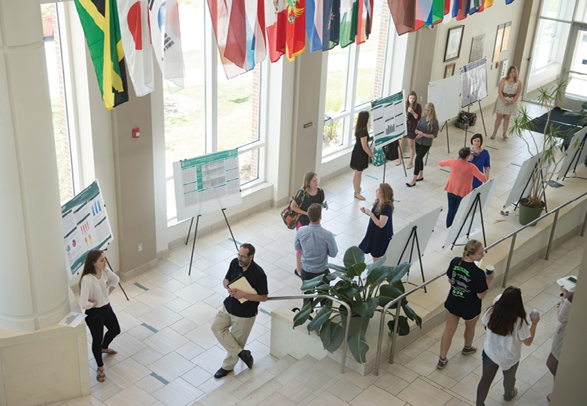 Study Hall: Students compete in poster sessions where they describe their research projects and findings.