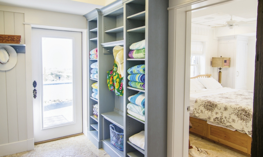Storage abounds throughout the house, with shelving for outdoor play and indoor living built into the walls and under the beds.