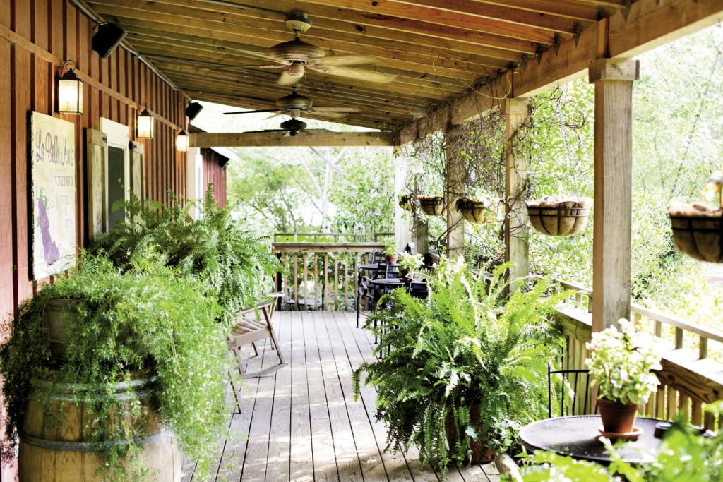 An inviting wrap-around porch and intriguing gift shop/tasting room have novices and connoisseurs alike enjoying the unique setting of La Belle Amie Vineyard, where visitors often stay for hours.