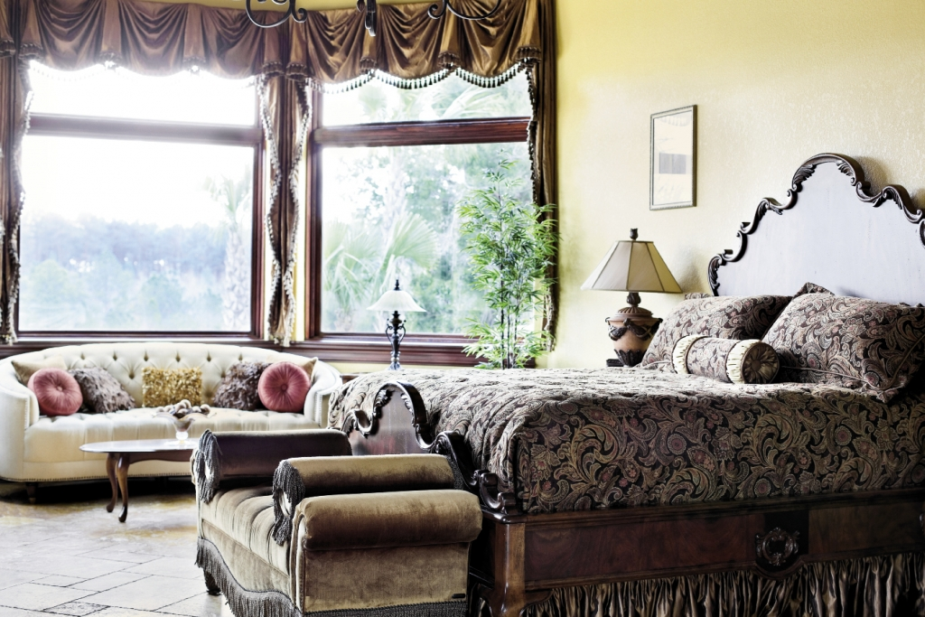 The master bedroom in the Martin home is a study in craftsmanship from the tile work to the cherry would built-ins.