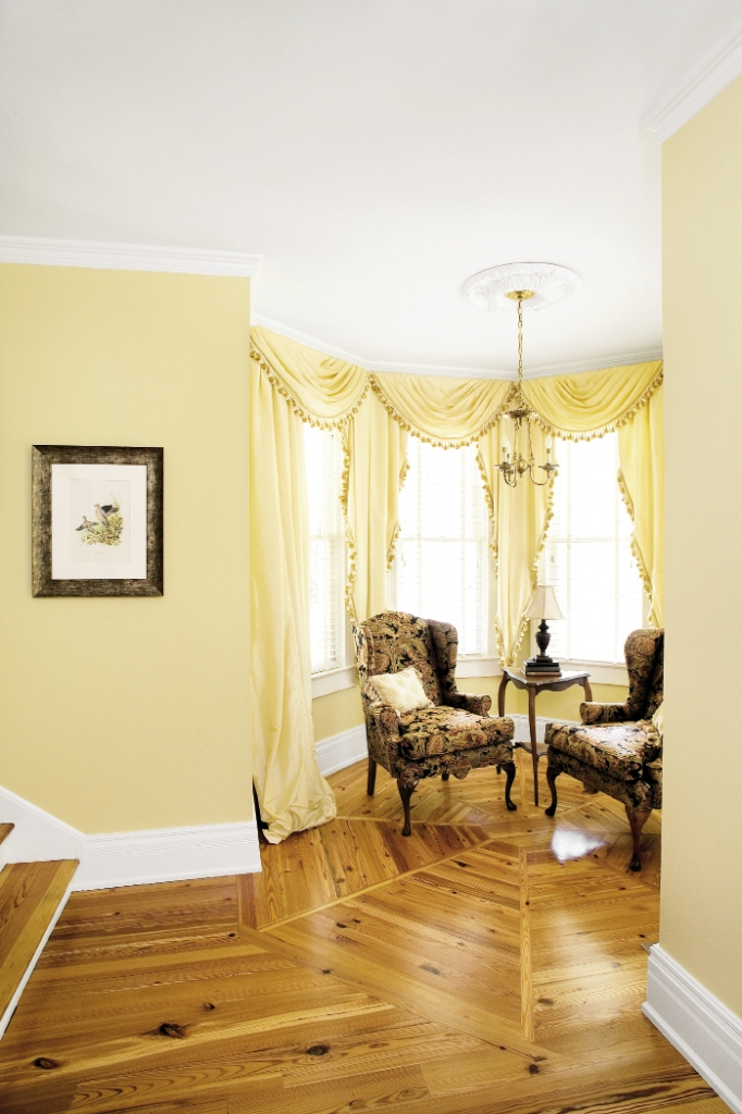 A former, very formal, receiving alcove becomes a cozy seating area perfect for morning coffee.
