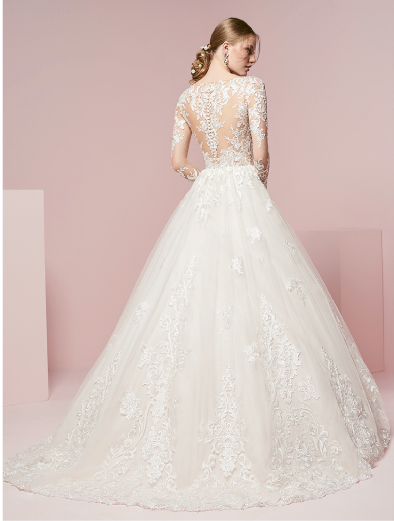 House of WU The sensual sheer lace bodice on this dress is a stunning update to a long-sleeved wedding gown. The softly gathered ball gown skirt is also accented with lace.  Amanda's Collection; $1,699