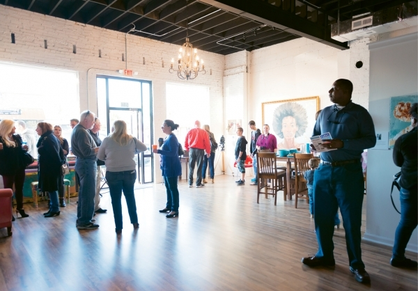 Senior students and art teachers from The Academy of Art, Science and Technology mingle with guests at Element Studio at the inaugural First Friday Art Walk in Myrtle Beach.