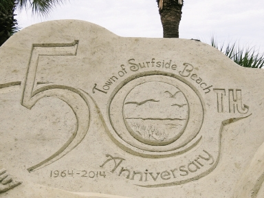 sand sculpture noting the Town of Surfside Beach's 50th anniversary in 2014.