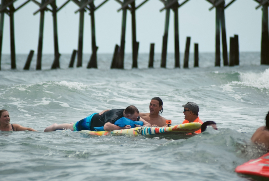 """It felt great. There's nothing like the ocean. I've missed it,"" Tracy Price said after surfing with the help of volunteers with Wheel to Surf in May. It was his first time in the ocean since he became dependent on a wheelchair after an ATV accident in 2004."