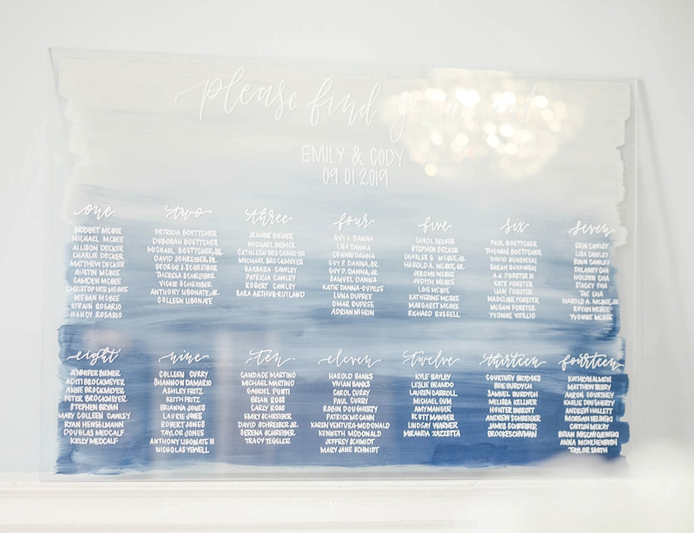 One of Emily's favorite design pieces was the blue acrylic seating chart.