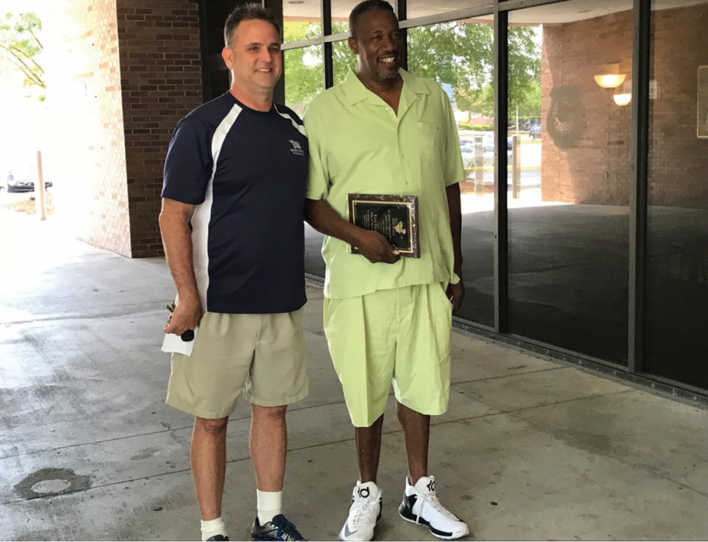 Kirk Gallion, left, with the city's Youth Sports Division, presented longtime volunteer coach Eric Goings, better known as Coach E, with the 2017 State Coach of the Year award by the South Carolina Recreation and Parks Association.