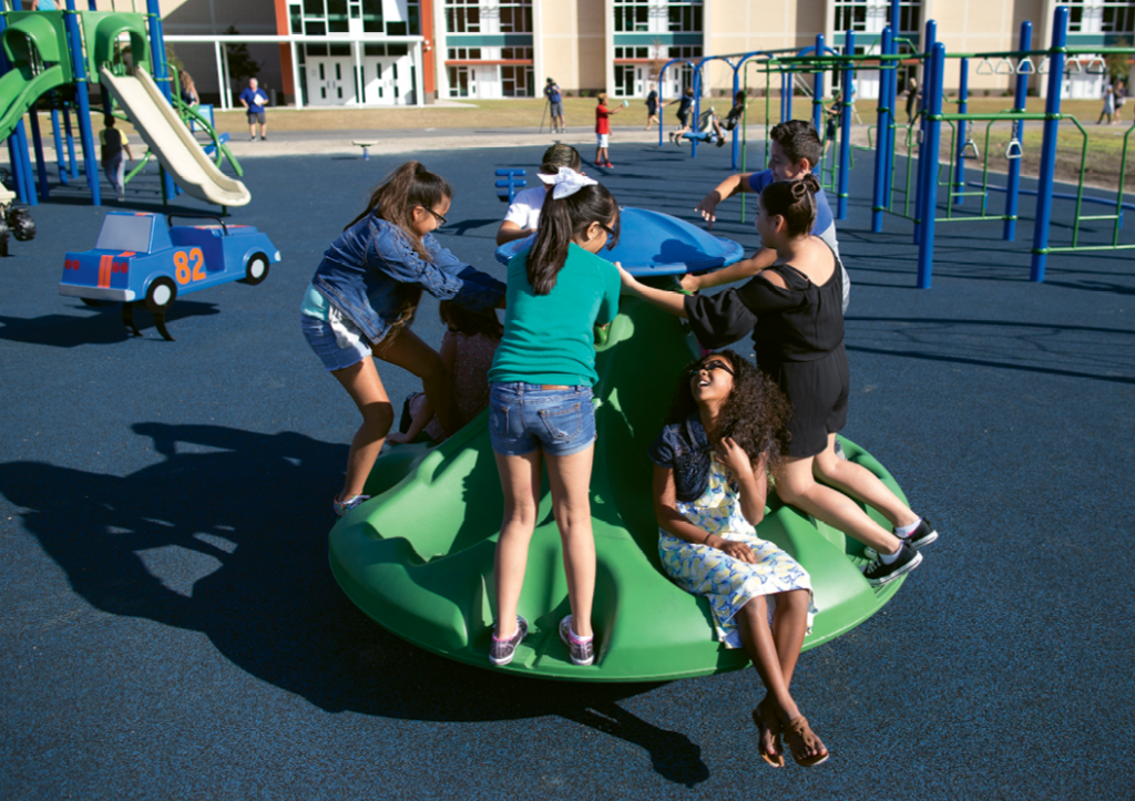 Children play during a recess in the cushioned mat playground at Socastee Elementary.