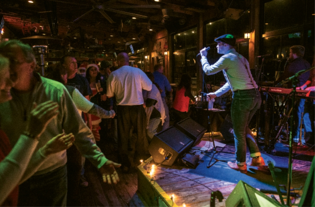 Timothy Hardwick of Oracle Blue gets the crowd dancing at a recent performance at Dead Dog Saloon in Murrells Inlet.