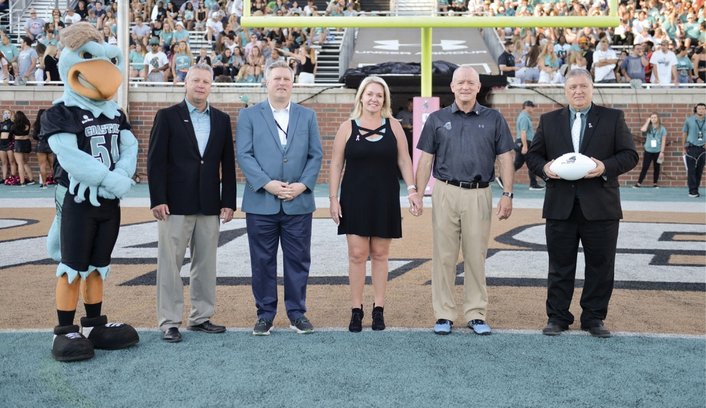 Left to right:  Chauncey, Chris Johnson (former Exec. Dir of the Chanticleer Athletic Foundation), AD Matt Hogue, donors Stacy and Wyatt Henderson (former board of trustee's member) and Dr. David DeCenzo.