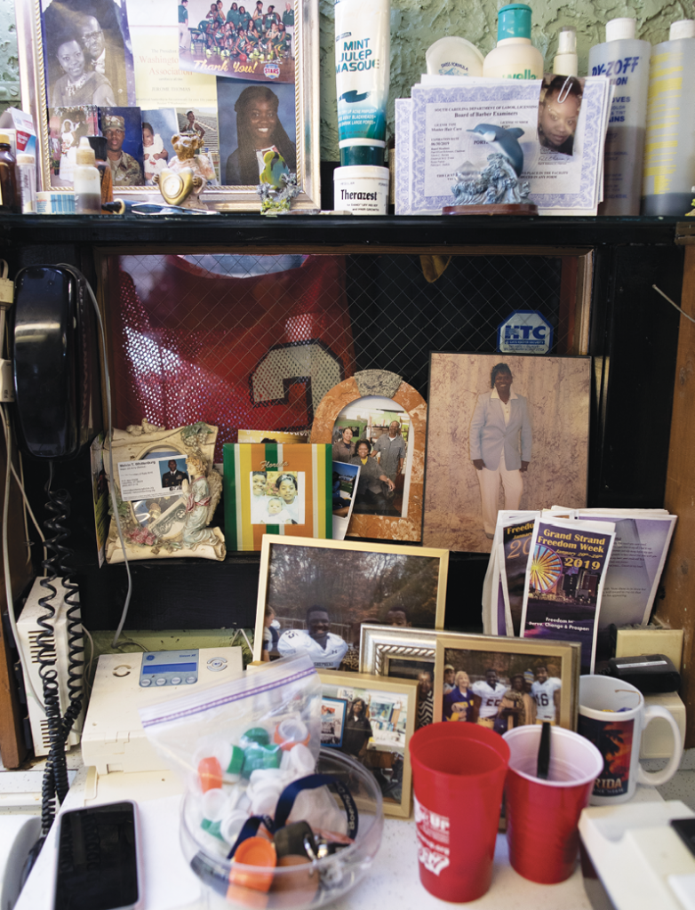 "Pictures of family and friends decorate the workstation of Ella Mae ""Dolly"" Thomas."