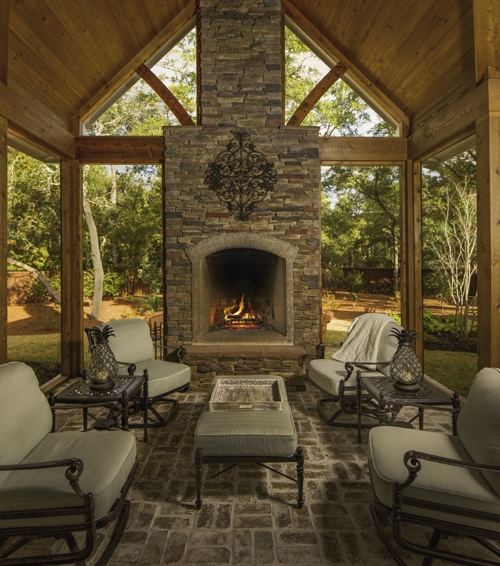Where Am I?: Sitting in the Clines' cedar-lined, screened-in porch with a wood fire burning in the stone hearth, you are minutes from the beach, but the setting could just as easily be a mountainside retreat.