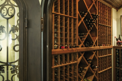 The Art Of Wine: Among a roster of refined details in the Cline home, a wine room holds vintages the couple brings in from the Napa Valley and incredibly detailed wine art by Thomas Arvid.