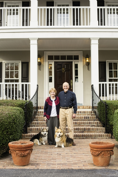 Welcome!: Laurie and John Stewart with their two beloved Welsh Corgis. The most recent renovation to their home was to turn a screened-in porch into an enclosed sunroom. As it turns out, both Laurie and John and the Corgis spend most of their time there now.