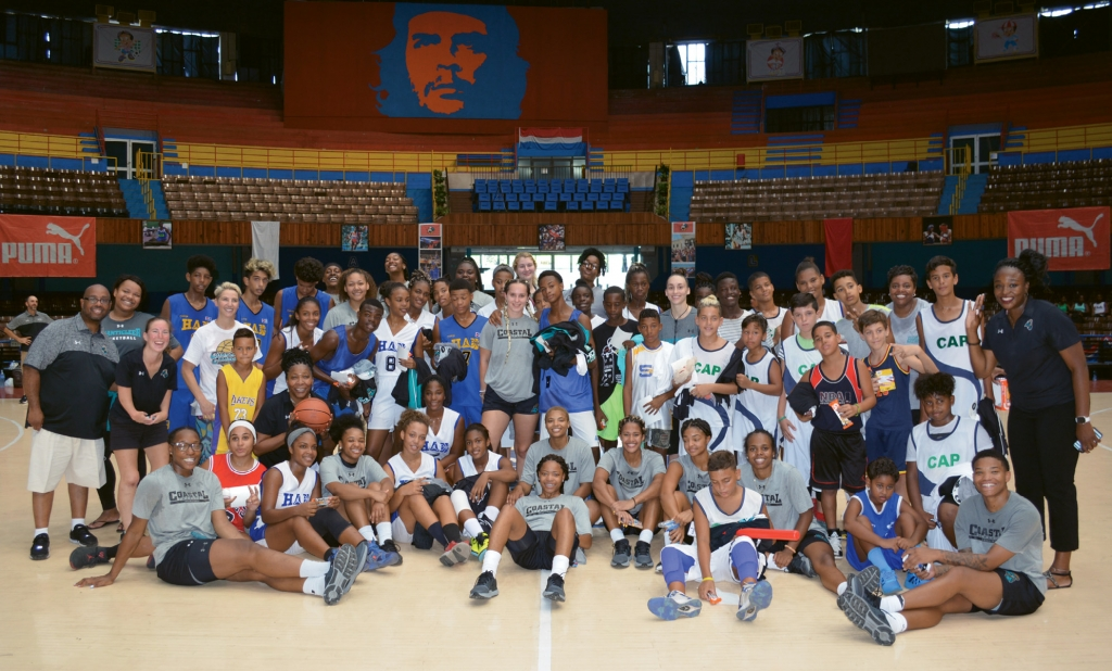 Coastal Carolina University's women's basketball team and children from Havana are all smiles after the team hosted a youth basketball clinic.