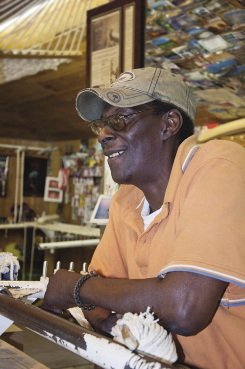 Marvin Grant, the master weaver at the Pawleys Island Hammock Shops, is always ready to greet customers and window-shoppers.