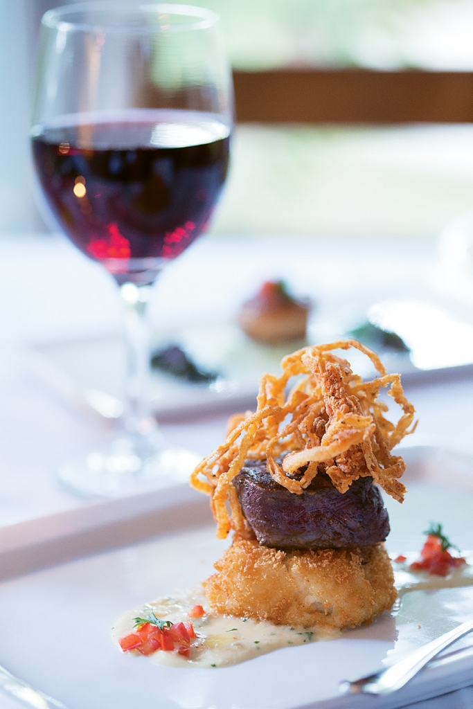 The grilled four-ounce beef tenderloin with tobacco onions, crisp risotto cake and roasted garlic horseradish sauce from Frank's.