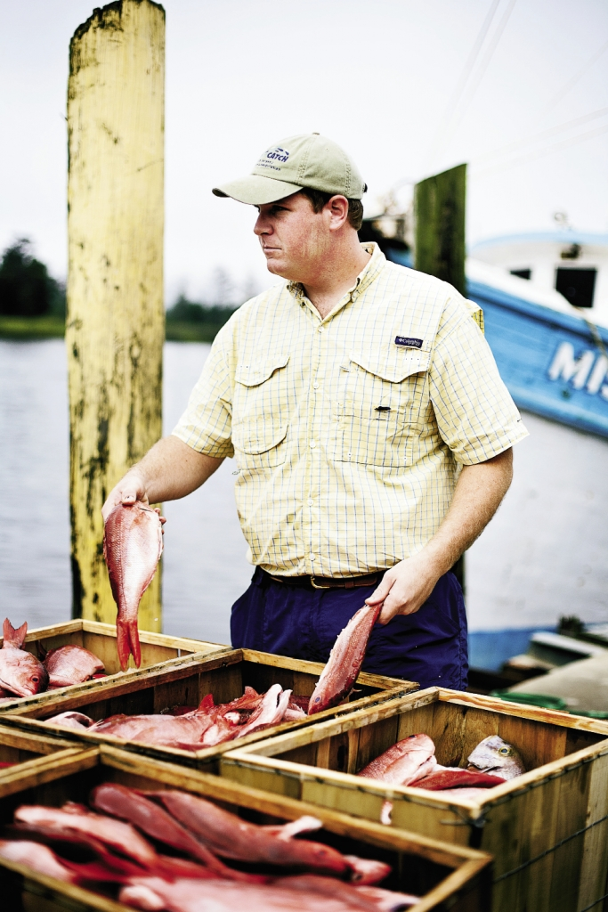 Fresh Off the Boat: Chris Conklin, owner of Seven Seas Seafood Market in Murrells Inlet, displays the red snapper catch.